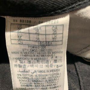 Guess medium rise, tapered leg black Jeans.